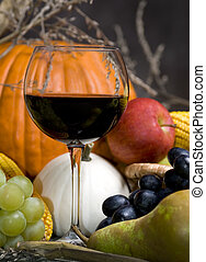 Harvest Wine 2 - A glass of red wine with the autumn fruits