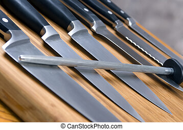 Kitchen Knives - A set of high quality kitchen knives on a...