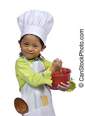 Little Chefs 004 - A young girl having fun in the kitchen...