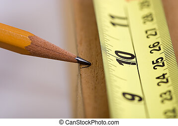 Mearsuring for the cut 2 - A woodworker measures the mark...