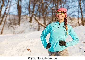 Warm up in winter Girl exercising in frozen park Health...