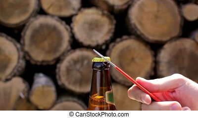 Opening a beer bottle. Slo-mo - Opening a beer bottle. Macro...