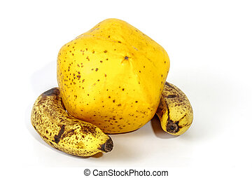 Yellow Paw Paw with Two Ripe Speckled Bananas - Studio shot...