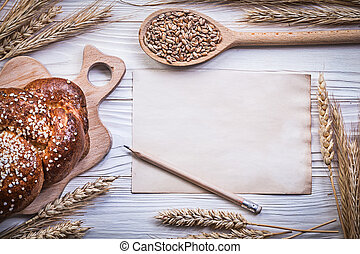 Chopping board wheat rye ears loaf of bread stick wooden...