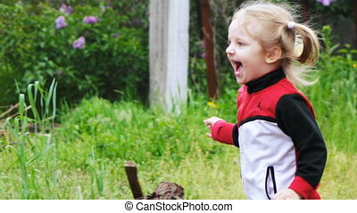 Girl running in garden - Little girl running older sister...