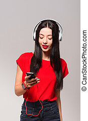 Positive woman listening to music - Feel the beat. Pleasant...