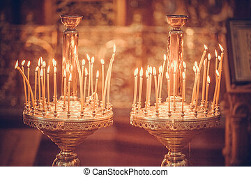Candles firing in church - Candles firing in the church,...