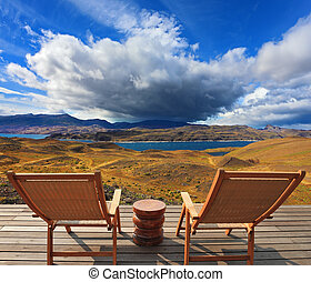 The park Torres del Paine - Pleasant holiday. Chile. Wooden...