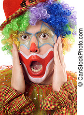Portrait of a terrified clown. Isolated on white
