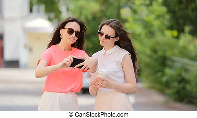 Young positive sisters having fun and making selfie. Concept...
