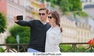 Selfie photo by caucasian couple traveling in Europe...