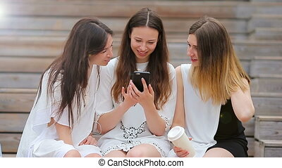 Lifestyle selfie portrait of young positive girls having fun...