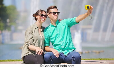 Young tourist couple traveling on holidays in Europe smiling...