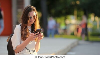 Young caucasian woman sending message and listen music...