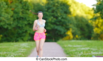 Beautiful young sport girl running outdoors Runner - woman...