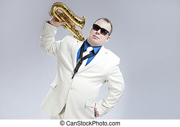 Portrait of Handsome Caucasian Saxophone Player With Music...