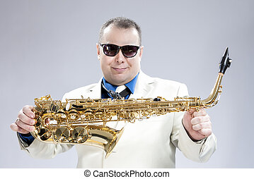 Smiling Happy Male Saxo Player in White Suit and Sunglasses...