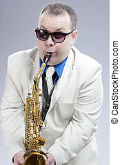 Portrait of Funny Caucasian Saxophone Player in Sunglasses...