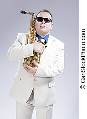 Male Saxophone Player Posing With Alto Saxo In White Suit...