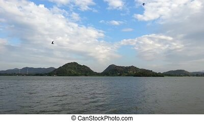 Jetski in lake and mountains with blue sky