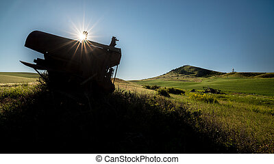 Old rusted combine and sunstar at Steptoe Butte - Steptoe...