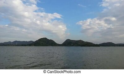 Jetski in lake and mountains, Timelapse