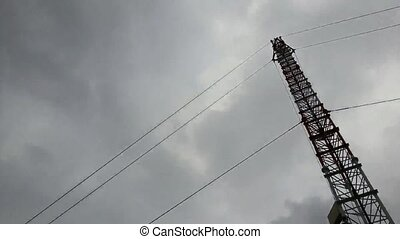 Antenna tower, Timelapse - Antenna tower with storm sky,...