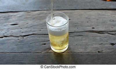 Beer pouring with ice in glass - Beer pouring in glass with...
