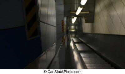 Escalator running up and down in indoor building