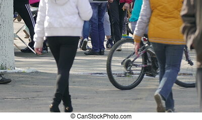 crowd of people walking park on street legs close-up