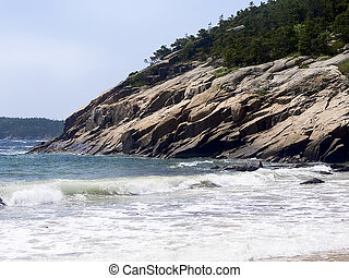 Sand Beach, Acadia National Park - Rocky cliffs that contain...