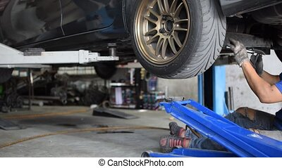 Checking car suspension - Bangkok, Thailand - January 22,...