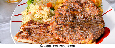 grilled chicken meat and burger serving in a plate - picture...