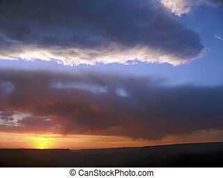 Strormy Grand Canyon Sunset - The sun sets below storm...