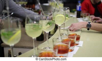 bartender prepare cocktail for women - on the bar. bartender...