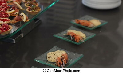 Canapes of shrimp on the table