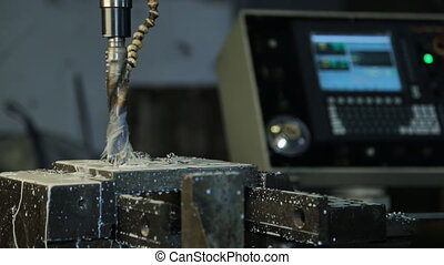 Automatic drilling on lathe with coolant on background of...