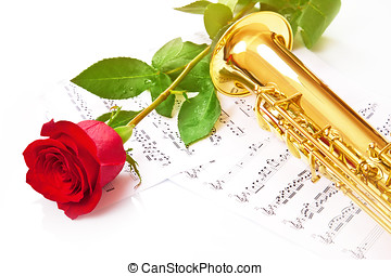 Red rose, saxophone and notes
