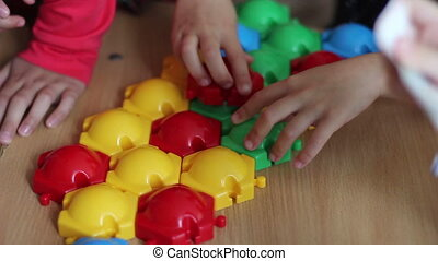 playing color constructor parts - Closeup of child's hand...