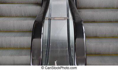 Escalator running up and down