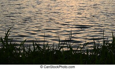 Sunset in evening time and wave of lake