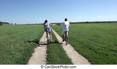 Summer field classical bicycling, slow motion steadicam shot...