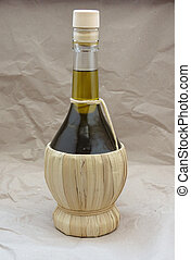 Olive oil flask - Olive oil in a traditional shaped straw...