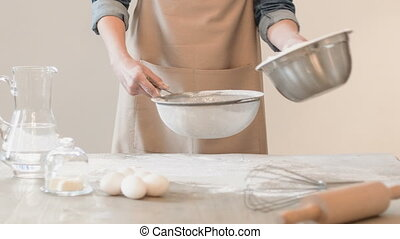 Pleasant baker sifting flour - Make with love. Pleasant...