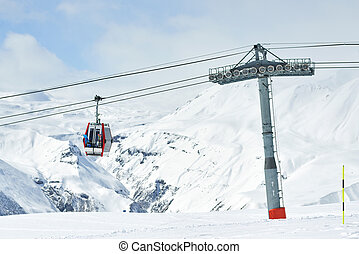 The gondola lift to the ski resort - Gondola lift in the ski...