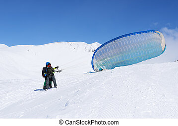 Education flights on paragliding in the winter in the...