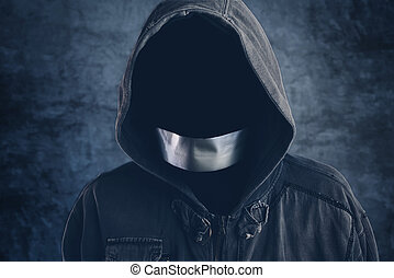 Unrecognizable hooded hooligan with mouth duct taped, spooky...