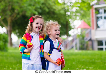 Kids on first school day - Child going to school Boy and...