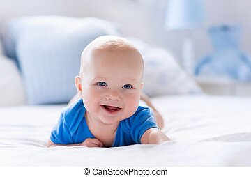 Baby boy in white sunny bedroom - Adorable baby boy in white...