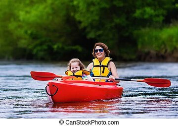 Mother and child in a kayak - Family on kayaks and canoe...